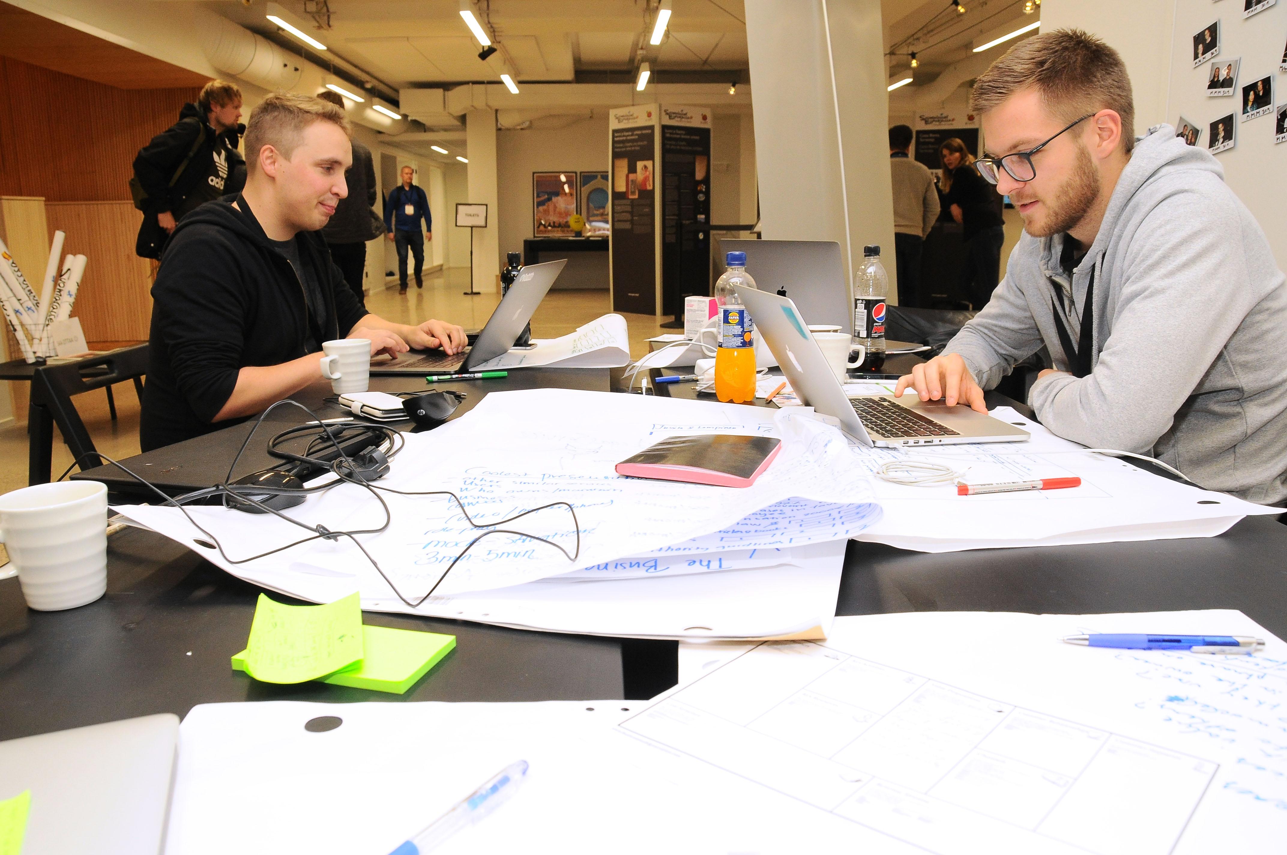 Felix and Olli working on laptops